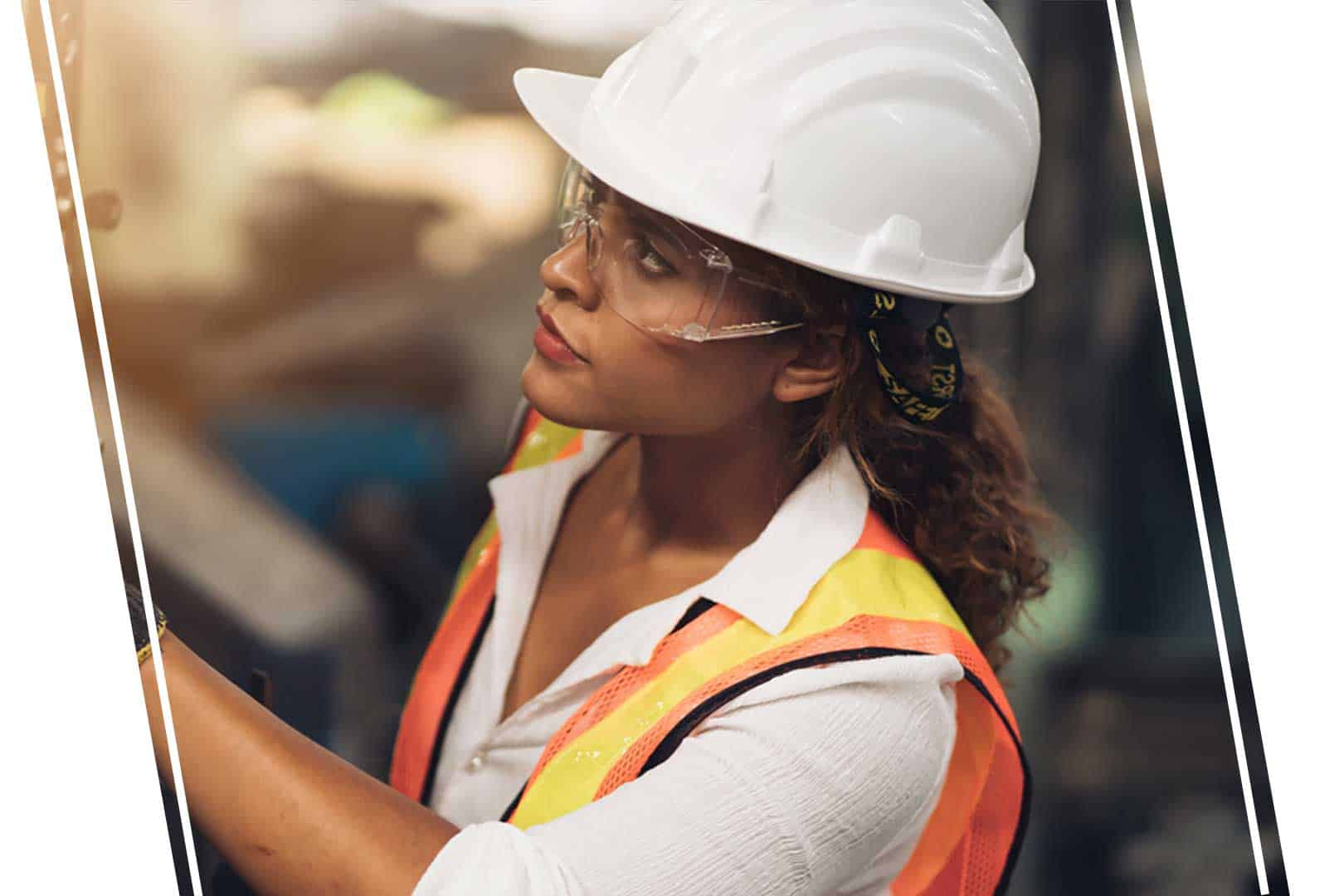 Female construction worker wearing a hardhat and goggles