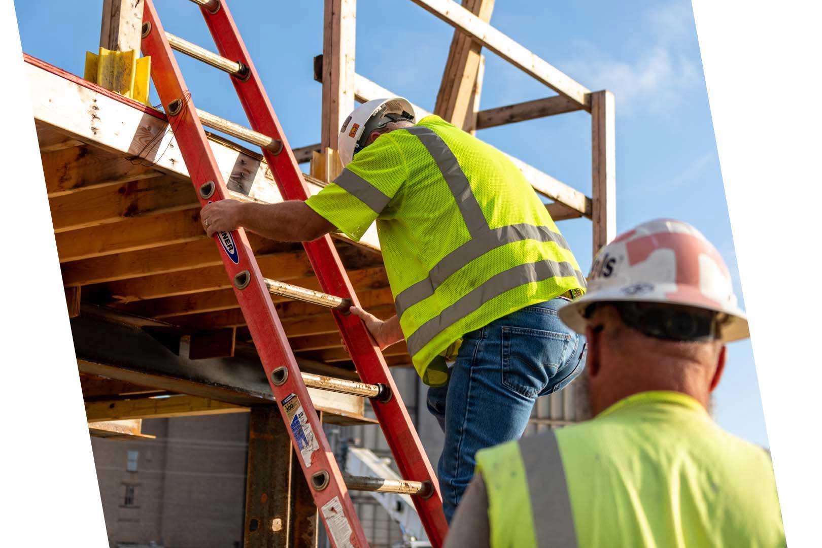 Construction worker going up a ladder
