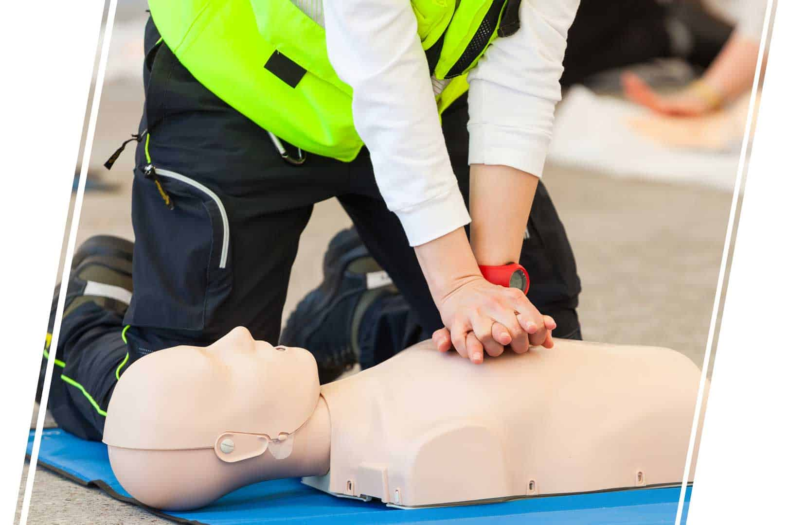 Hands performing CPR on a test dummy